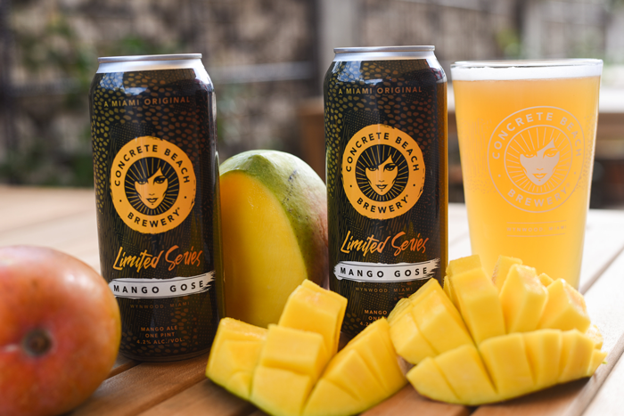 Cans of Mango Gose and sliced mango