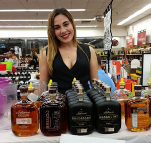 Woman in black top pictured with several varieties of Jefferson Bourbon